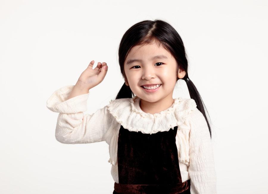 K-2nd Happy Asian girl raising hand